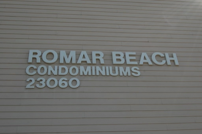 Romar Beach Condominiums Sign